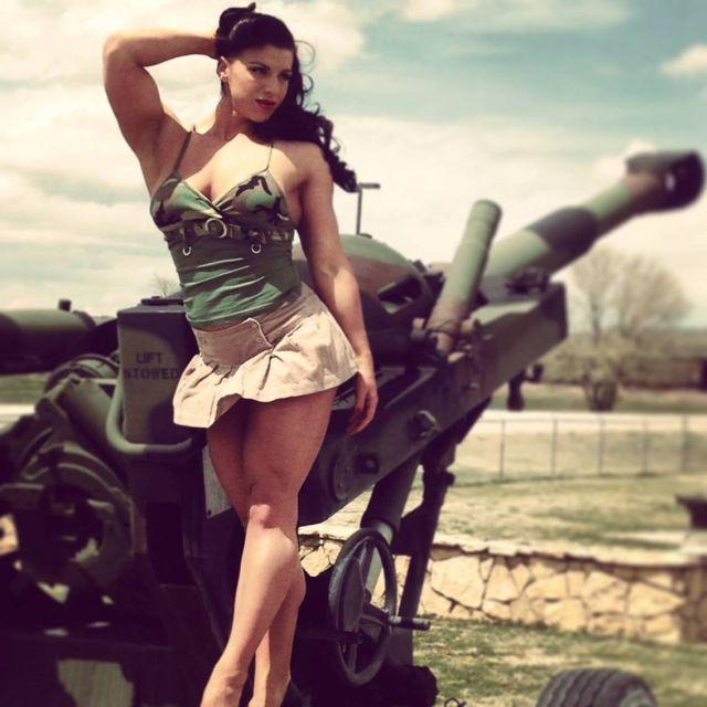 ariel-gail-military-outfit-near-artillery-gun