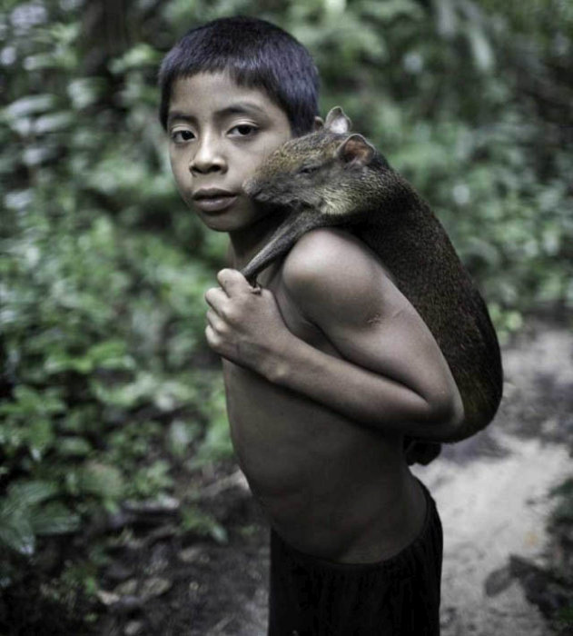 awa_amazon_tribe_breastfeeds_animals_10